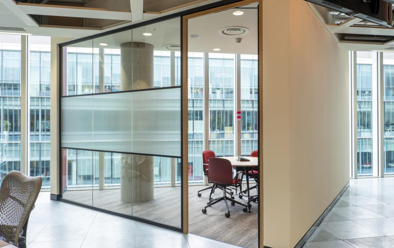glazed meeting area in agile office