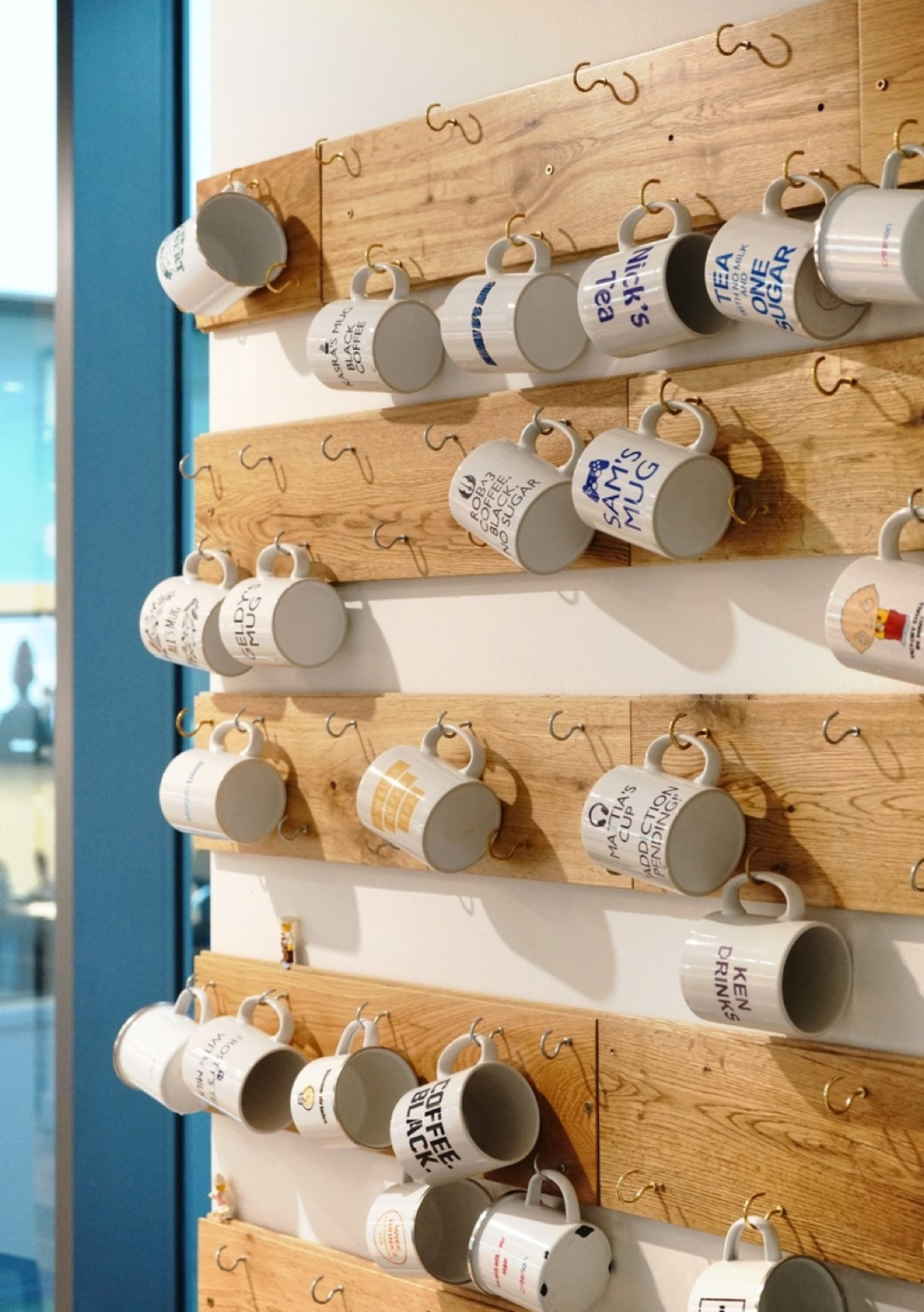 Personalised hanging mug walls in an office