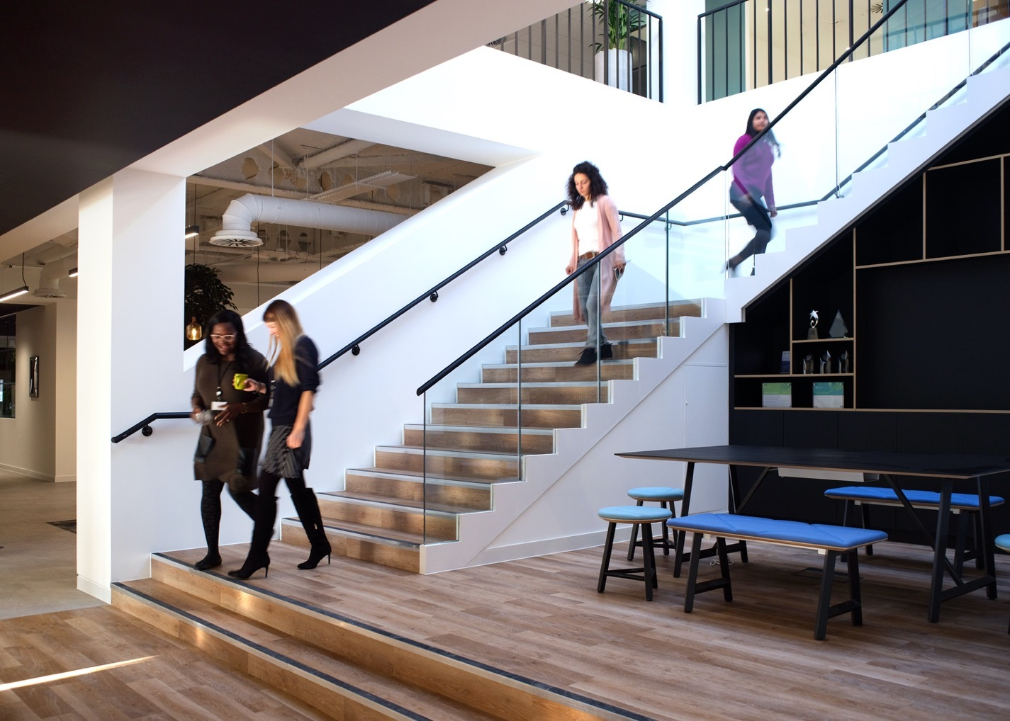 Bottomline stairs in natural wood in office space design