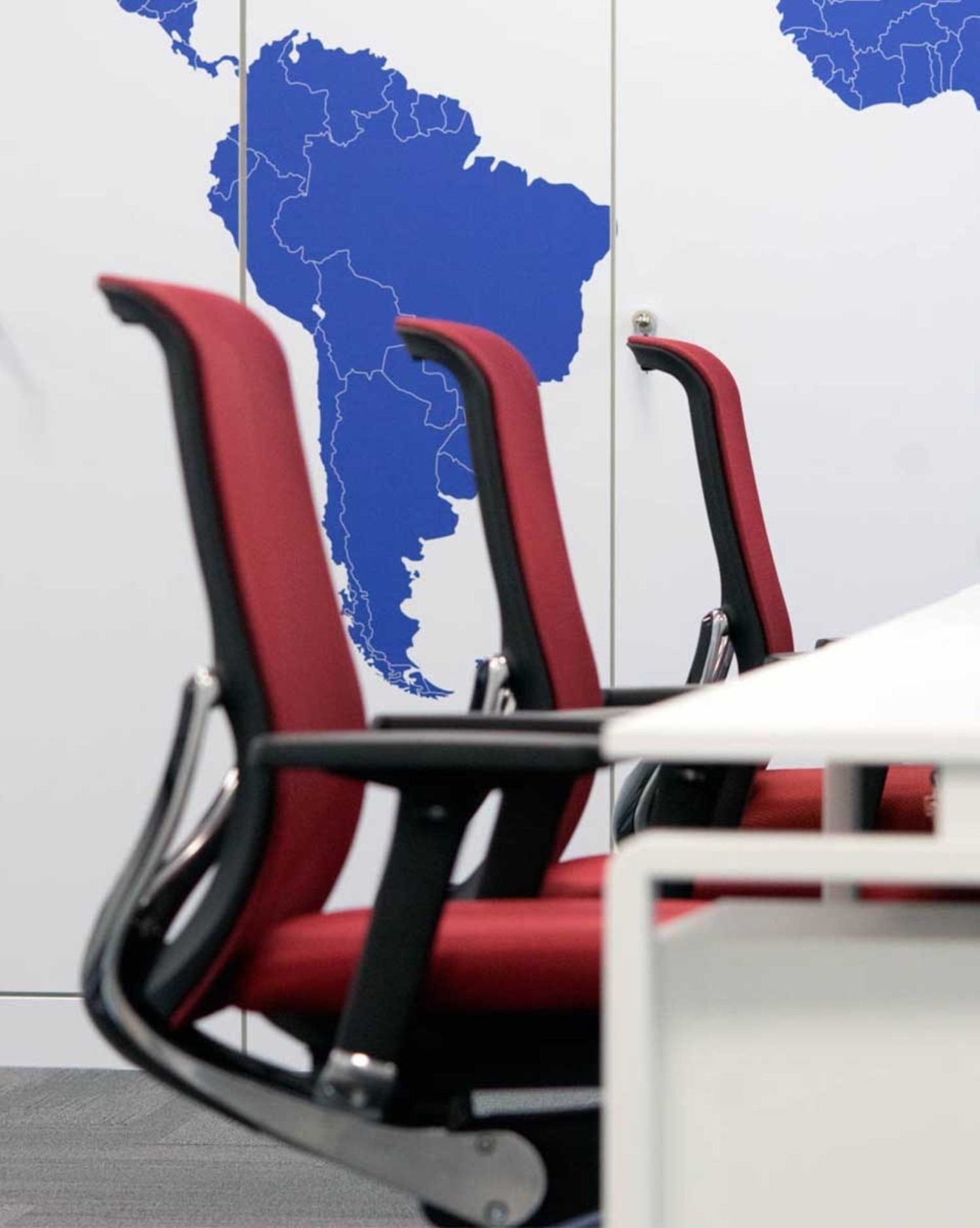EUSA Pharma red chairs in open plan office design