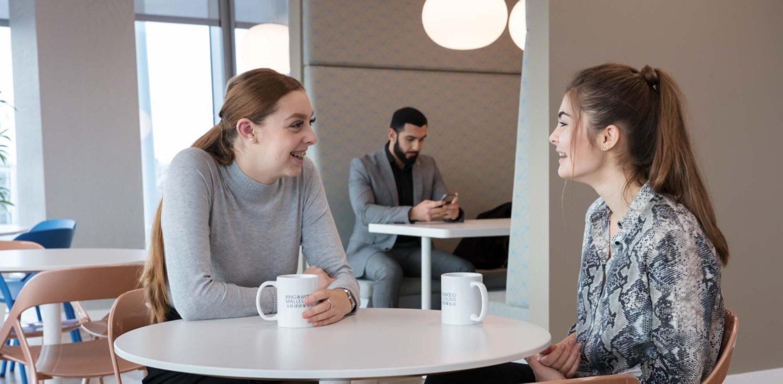 King & Wood Mallesons staff talking in flexible breakout space
