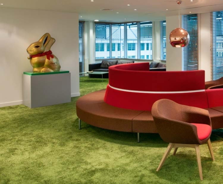 Lindt curvy sofa green carpet office design
