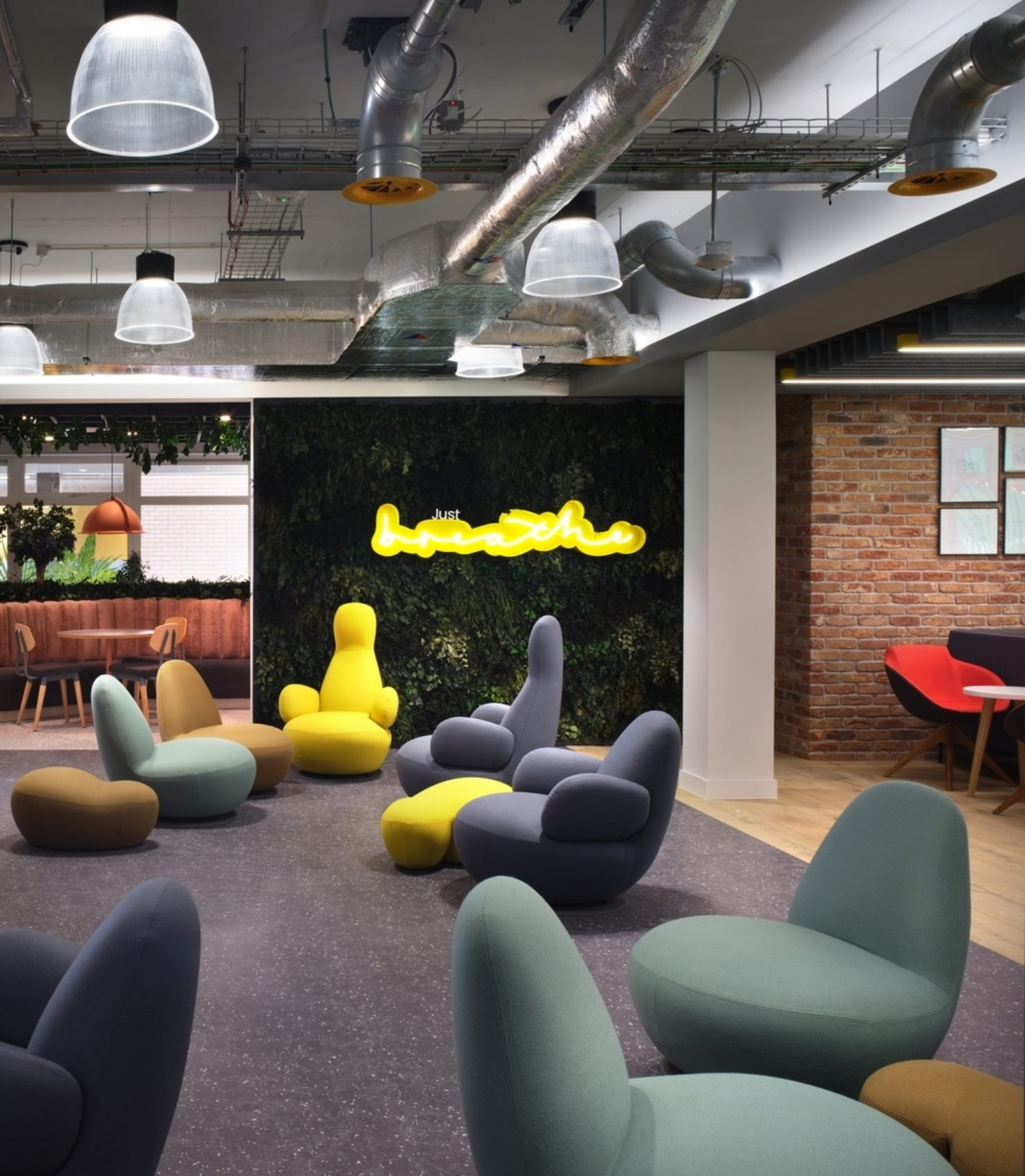 Contemporary office interior design with colourful soft furnishings