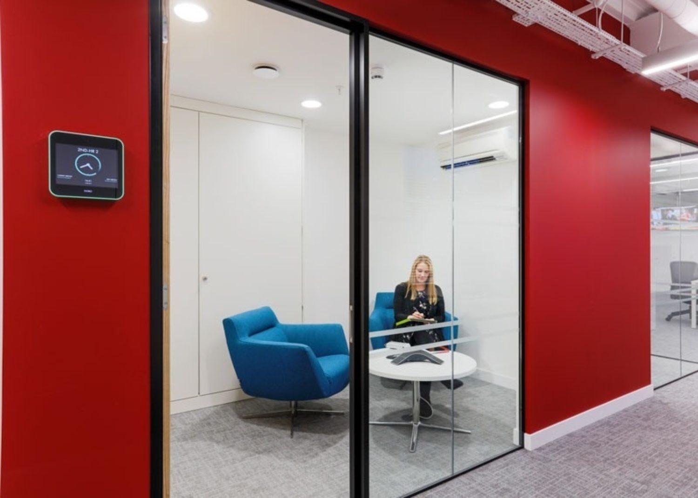 Woman using smart meeting room technology