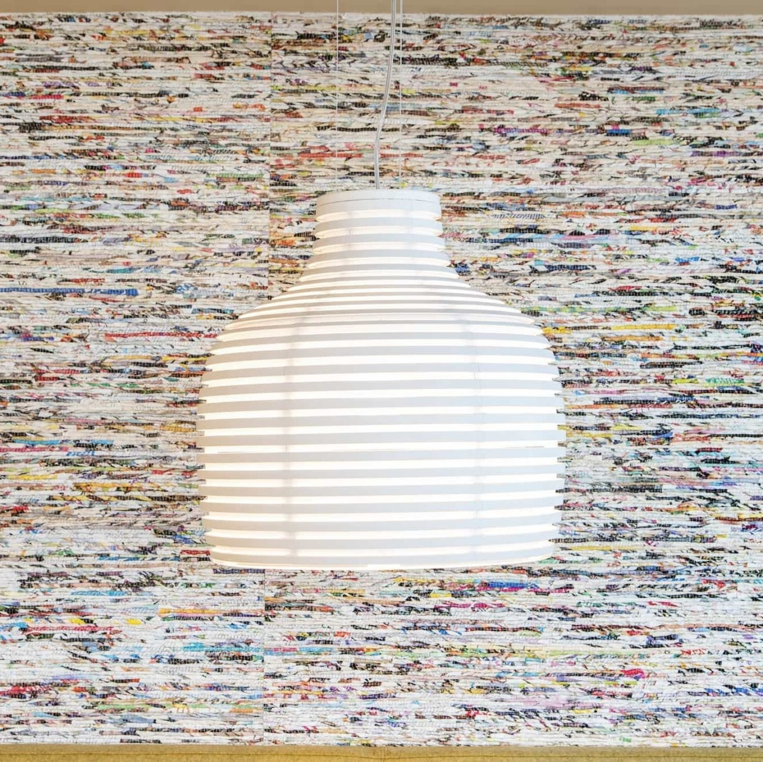 Textured wall and light from recycled materials