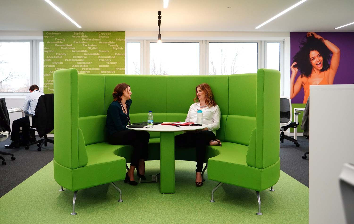 Green soft furniture in breakout area