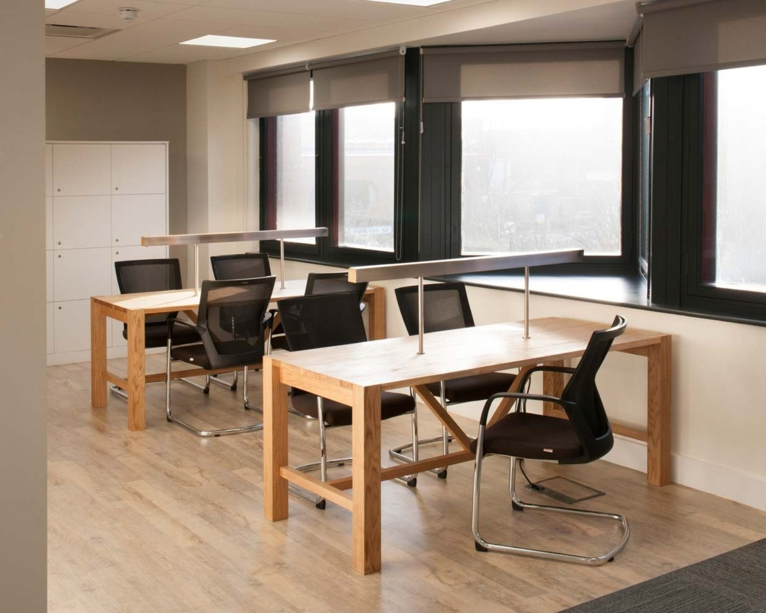 Open plan office design with natural wood