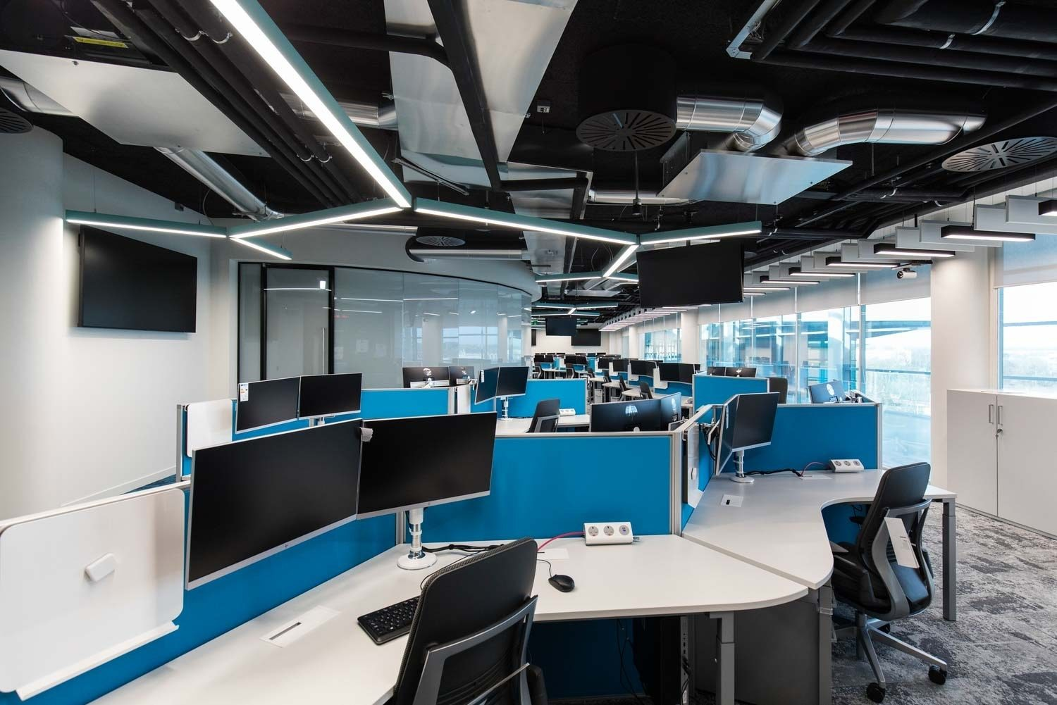 Computer monitors in open plan office